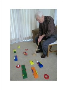 Geriatric Chair Crazy Golf for Dementia Patients. Working on forward flex ion for completion of functional transfers