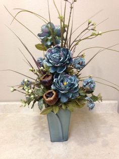 """Photo: Address of the retailers [[caption id="""""""" align=""""aligncenter"""" and green floral in black vase at Michaels Artificial Floral Arrangements, Faux Flower Arrangements, Flower Centerpieces, Artificial Flowers, Flower Decorations, Silk Flowers, Dried Flowers, Beautiful Flowers, Blue Flowers"""