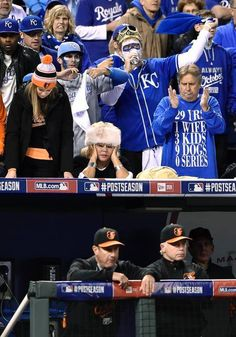 Baltimore Orioles manager Buck Showalter watches from the railing as fans react in the ninth inning as the Kansas City Royals won 2-1 during Tuesday's ALCS baseball game on October 14, 2014 at Kauffman Stadium in Kansas City, Mo.