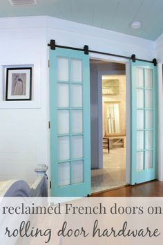 Add some color to your space with blue french doors, hung on rolling hardware. Get the tutorial at The Space Between.