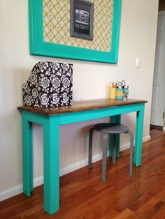 """Repurposed entry table painted in Pantone's """"Pool Green"""" from Lowes."""