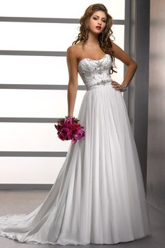 This #weddingdress is a perfect balance between statement and simplicity! {Sottero and Midgley}