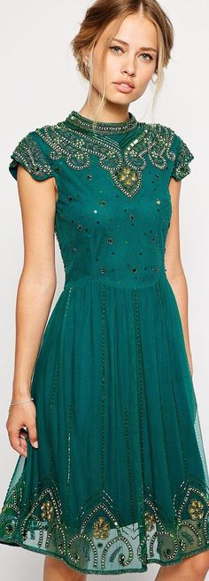 this dress is actually a decent length which is really surprising to see these days. super cute! green short dress.