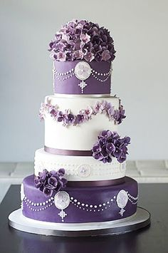 Deep purple wedding cake www.finditforweddings.com floral trim