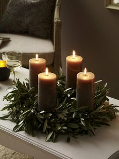 Interesting idea with olive leaves and ? what color are those candles? Nice.