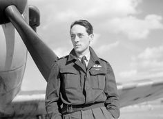 """Acting S/L Brian JE """"Sandy"""" Lane of No 19 Squadron RAF is pictured at RAF Fowlmere by a press photographer on 21 September 1940. Some of the unit's pilots, including its 23-year-old CO, were wearing battledress, which had yet to be widely issued. Examples of Suits, Aircrew were known to be around from 1938 for field evaluation purposes."""