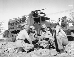 American and Chinese troops resting next to a truck in the first convoy on the Ledo Road from India and Burma into China, early 1945