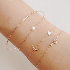 Rosegold bangle + pearl +moon crescent and star + snake//