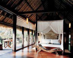An open-air bedroom      An open-air bedroom  at Como Shambhala Estate.