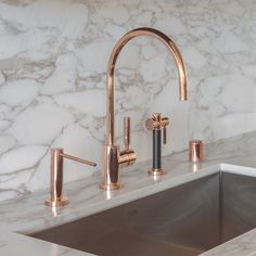 Rose gold faucet in a Pacific Heights kitchen by Richard Felix-Ashman of Handel Architects   Photo by David Livingston