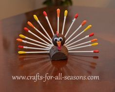 This little turkey has a tail of paint dipped cotton swabs. It can easily be turned into a place name holder by sliding an index card in between the tail feathers.