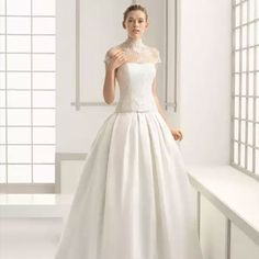 This dress is retro-inspired in a very Grace Kelly kind of way. Glamorous and elegant, they both embrace this traditional silhouette in a modern way, with a slight drop waist and pockets.