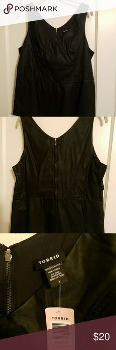 Torrid Faux Leather Top Super cute faux black leather top.  Top lined in the front and back.  Bottom slightly flares.  Very sexy and flattering.  Zipper in the back.NWT Tops