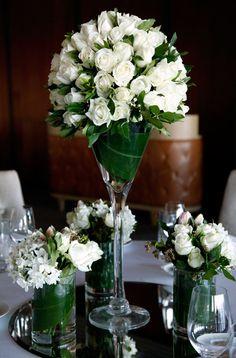 flower arrange in wine glass  | Roses in martini glass centrepiece arrangement