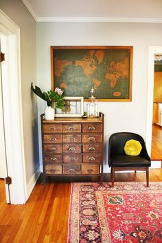 love the combo of rug + chair + map + dresser.