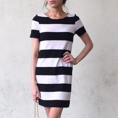 H&M Striped Shift Dress Black and white striped H&M short sleeved shift dress. Worn only 2 times.  Like new. H&M Dresses