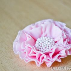 I love making ruffled flowers to dress up my cakes. I almost always make these flowers because they're quick and easy to put together. I hav...