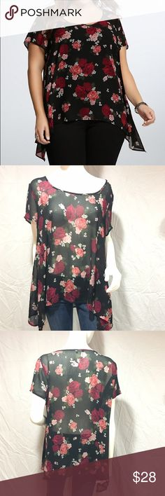 Floral chiffon sharkbite blouse Adorable floral chiffon blouse. Longer on the sides. Has short sleeves. Sheer material, loose fitting. Has pink and red roses, green leaves, and white flowers on a black background. Size 0 from torrid, which equals a 0x. Super cute and in great condition. Feel free to make me a reasonable offer  torrid Tops Blouses