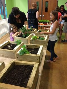 each child to plants and takes care of their own mini garden.