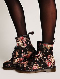 . Here is why I love them: rugged styling with a pretty floral print, so much fun. Makes them quirky! They come with two sets of laces, she often wears one on each boot. One set is the black shown here, the other is pink ribbon. I love that Dr.Marten has finally made some Girly versions of their boots!