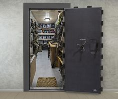Turn your room into a vault with the Liberty Vault Door! It combines style with superior theft and fire protection for an elegant look that fits any style. In Wall Gun Safe, Gun Safe Room, Hidden Gun Rooms, Hidden Gun Storage, Safe Room Doors, Safe Door, Gun Closet, Reloading Room, Safe Vault