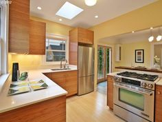 Multnomah kitchen, bamboo cabinets and floors, stove with built in vent