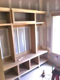 Mudroom...lockers in progress...a nice pic for inspiration but instead of the middle top extending out, I would have it extend upward... higher than the two sides.