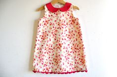 This A-line sleeveless handmade dress is made of 100% cotton fabric. It has a traditional japanese pattern of sakura flowers in pink colour over a