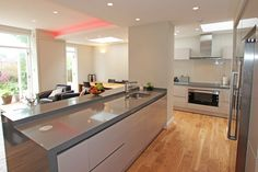 Gloss Cashmere Kitchen with Island - Handleless gloss kitchen island design - Discover more at www.lwk-home.com