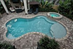 Tampa Bay pool builders since We will custom design your top-quality residential or commercial pool at an affordable price. Lets design your new pool! Backyard Pool Landscaping, Backyard Pool Designs, Small Backyard Pools, Swimming Pools Backyard, Swimming Pool Designs, Outdoor Pool, Riviera Pool, Small Inground Pool, Florida Pool