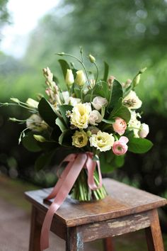 fragrant bridal bouquet with cream lisianthius, chamomile, White Majolica spray roses, tuberose, peach ranunculus and magnolia foliage, by Floral Verde LLC, Cincinnati Ohio wedding flowers