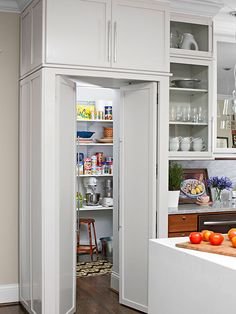 Walk-in Pantry Cabinet Ideas Hide a walk-in pantry built behind the kitchen walls by installing an upper cabinet with cabinet-look doors below. This fool-the-eye solution provides extra storage in the bulkhead and a seamless look in the kitchen.