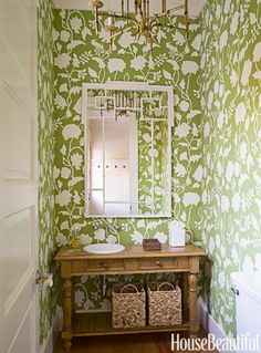 """""""A powder room is a great place to make a big wallpaper statement. This one, from Quadrille, has pizzazz and wraps itself around you."""""""