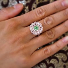 "dupuisauctions: ""A Rare Gem. This ring is set with a 1.33 cts fancy intense green diamond of natural colour, framed by round pink diamonds and further surrounded by pear-shaped diamonds. This ring..."
