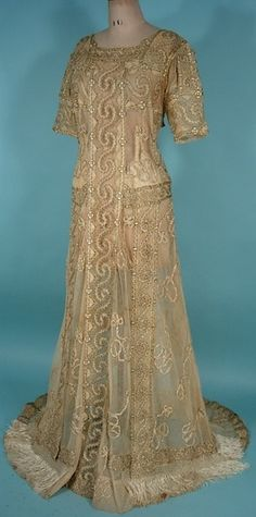 """Guinevere"" Camelot Ecru Net Trained Lace Gown, 1910. From antiquedress.com"