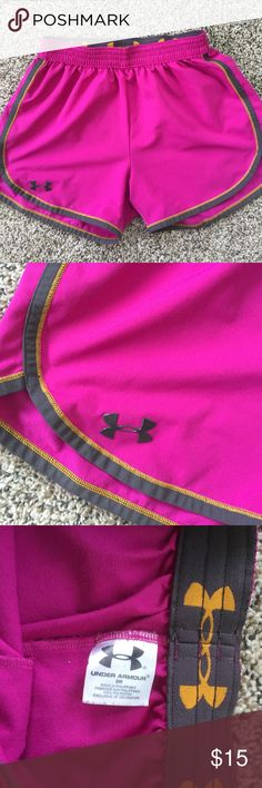 Under Armour shorts Fuchia color.  Good condition.  Elastic waist. Under Armour Shorts