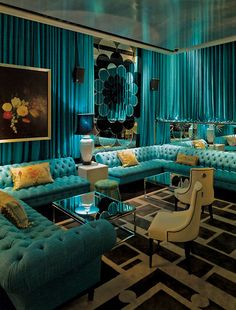 Turquoise ottomans and curtains at The Den: a stylish bar that is part of the Ivy entertainment complex in Sydney