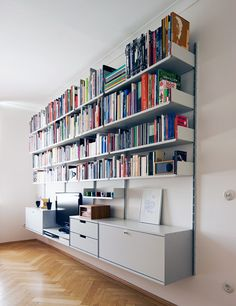The low double shelf is the natural height for this customer's lower seating; DVD player under the TV. Note shallower shelves at mid height make room feel bigger; deeper shelves above Shallow Shelves, Deep Shelves, Dieter Rams Design, Home Library Design, Muebles Living, Shelving Systems, Shelf System, Shelf Furniture, Living Room Shelves