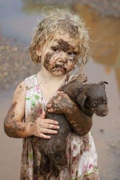 muddy love - as I understand it, this brave little girl refused to leave her family's home during a flood without her puppy - so she went back in and saved him!