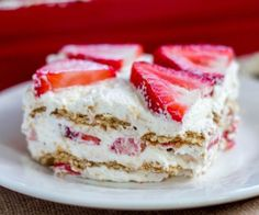 The graham crackers get soft and cake-like and are stuffed between layers of sweetened whipped cream and juicy strawberries. - Sprinkle Some Sugar