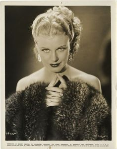 I chose this because she's very pretty and the fur is something I would picture during the Great Gatsby the way life is described. ginger rogers