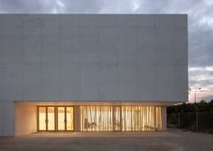 Sports hall for Escola Gavina school in Spain has multi-hued clay and glass tiles