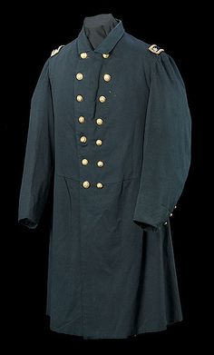 Union Field Officer Frock Coat, an uncommon late-war frock coat with fold-down collar identified to Lt. Colonel Horace Kellogg,123rd Ohio Volunteer Infantry. Dark blue wool frock of typical construction, double-breasted with two rows of seven buttons mounted with original Lt. Colonel's shoulder straps.