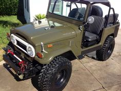 Another View: Drab Green Toyota Landcruiser FJ40