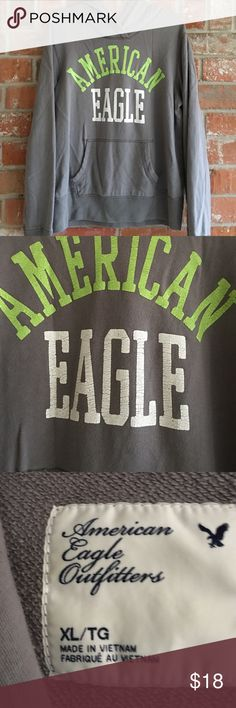 "AE Hoodie XL This hoodie is in great condition. No rips stains or tears. The ""crackel"" look on the lettering is supposed to be like that. I bought it that way. It measures 23"" underarm to underarm and is 27"" long American Eagle Outfitters Tops Sweatshirts & Hoodies"