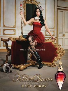 So photoshopped she doesn't even look like a person! Killer queen! Katy Perry shows off her tiny waist in a corset and ruffled skirt as she perches on the side of an upturned throne for her new perfume advert