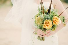 Lavenders Blue wedding bouquet with vendella and combo roses, arabacum flower and chrysanthemum daises, with lots of green and brown foliage. Click on the image to see the rest of this real wedding gallery: a charming rustic celebration at Newton Hall, Northumberland.