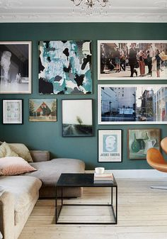 Living Room | In the living room, Ditte splashed out on color, painting the walls a deep sea green by Farrow & Ball.