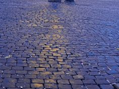 Cobblestones of Rome http://inpursuitofadventureblog.wordpress.com/2013/07/10/rome-city-profile/