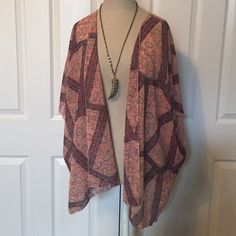 Printed Kimono A kimono for any occasion, jeans or dresses both welcome! It is in brand new condition and was only worn once. This kimono is thin, lightweight and made up of 100% polyester. Accessories